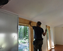 9steve-putting-up-curtain-rods